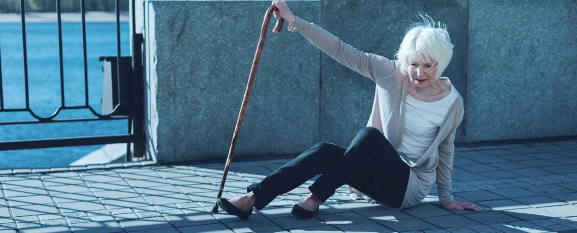 Elderly woman falling walking on footpath